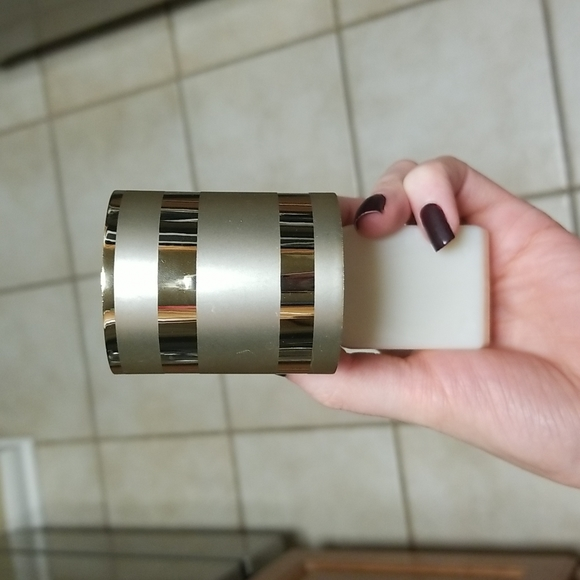 Gold striped wallflower plug from bath and body works